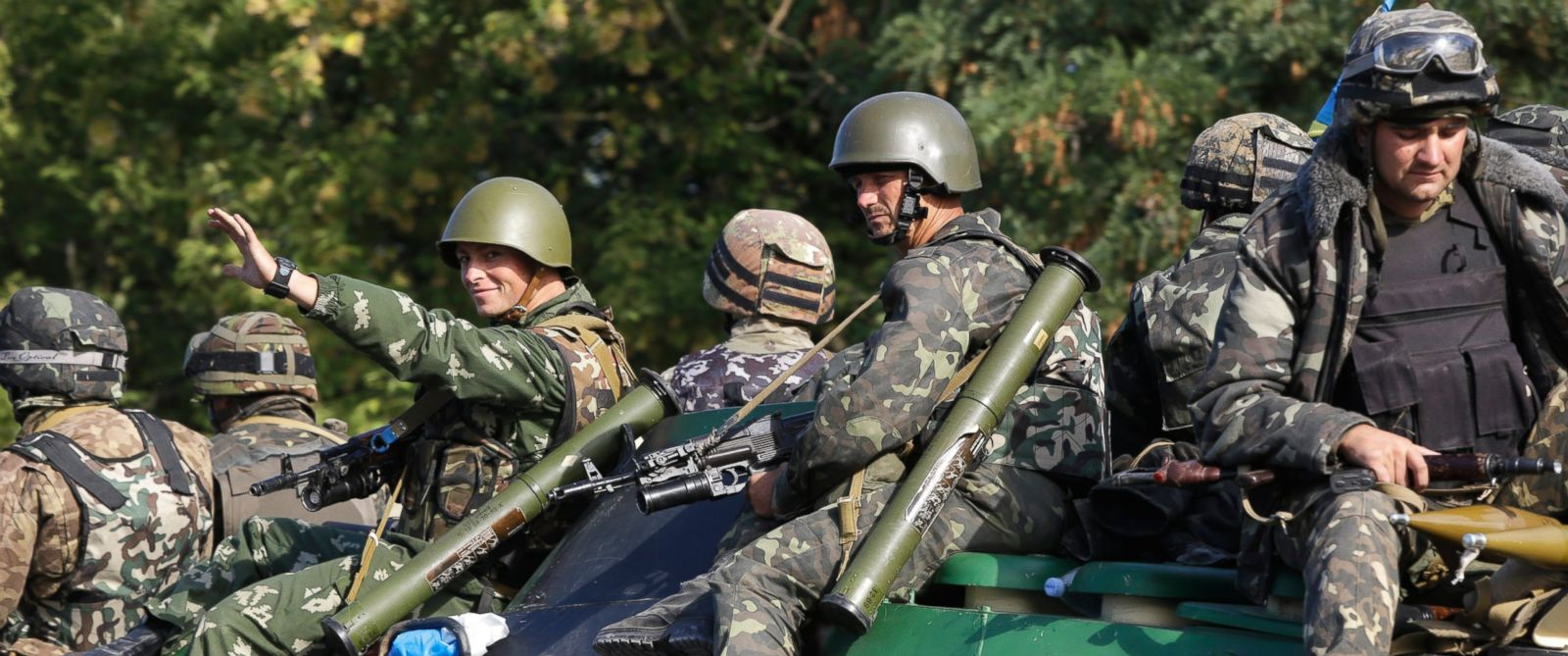 PHOTO: Ukrainian soldiers ride atop an APC near the village of Sakhanka, eastern Ukraine, Aug. 27, 2014.