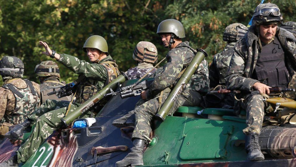 PHOTO: Ukrainian soldiers ride atop an APC near the village of Sakhanka, eastern Ukraine, Aug. 27, 2014.