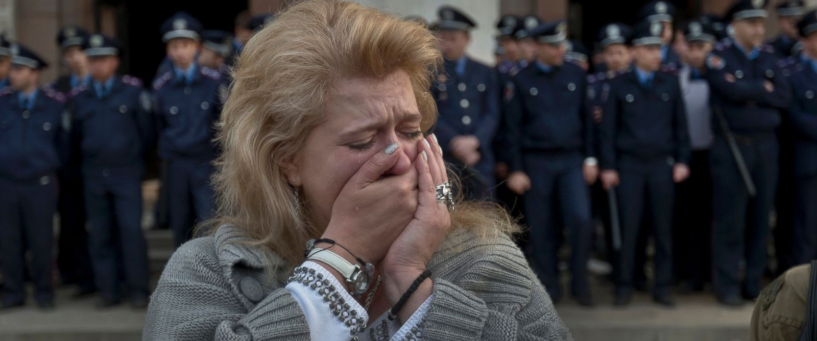 PHOTO: A woman cries back dropped by police troops guarding the burnt trade union building in Odessa, Ukraine, May 3, 2014, where more than 30 people died trying to escape during clashes the day before.