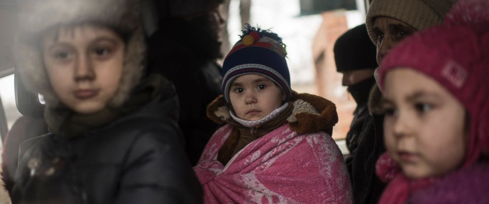 PHOTO: Ukrainian children look through a window of a bus near Artemivsk, eastern Ukraine, Thursday Feb. 5, 2015, as people are evacuated from Debaltseve.