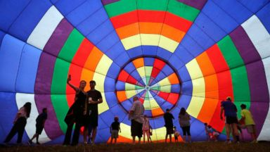 PHOTO: People walk around inside a partially inflated hot air balloon at the 32nd annual OuickChek New Jersey Festival of Ballooning, July 27, 2014, in Readington, N.J.