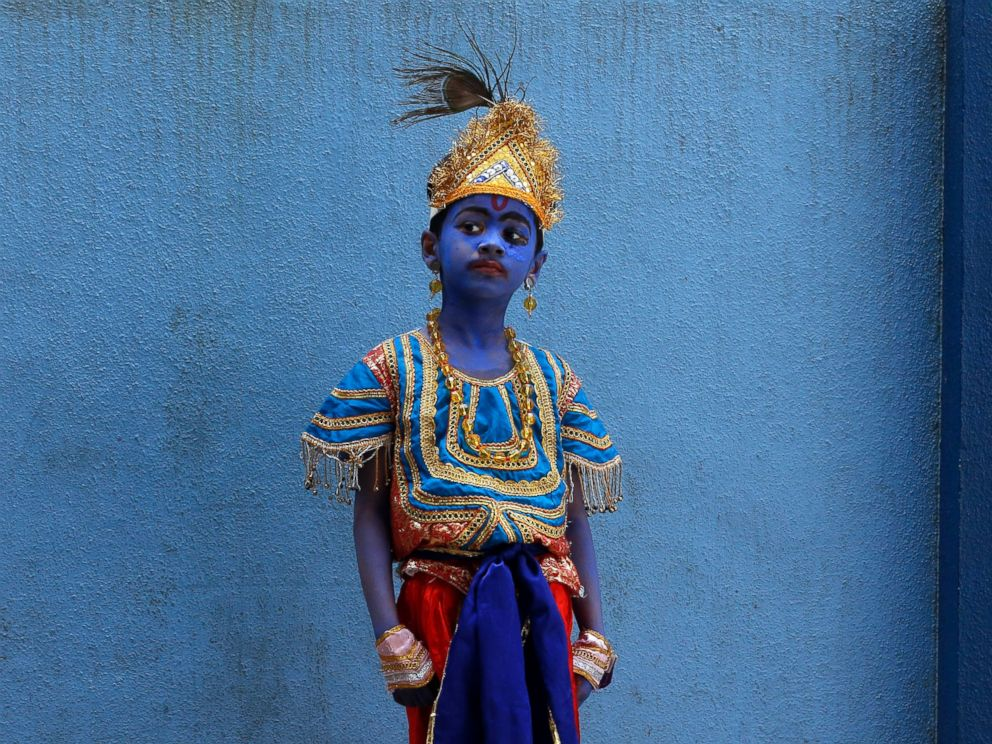 PHOTO: A boy dressed like Hindu Lord Krishna waits to attend celebrations on the eve of Janmashtami at a school in Mumbai, India, Sept. 4, 2015.
