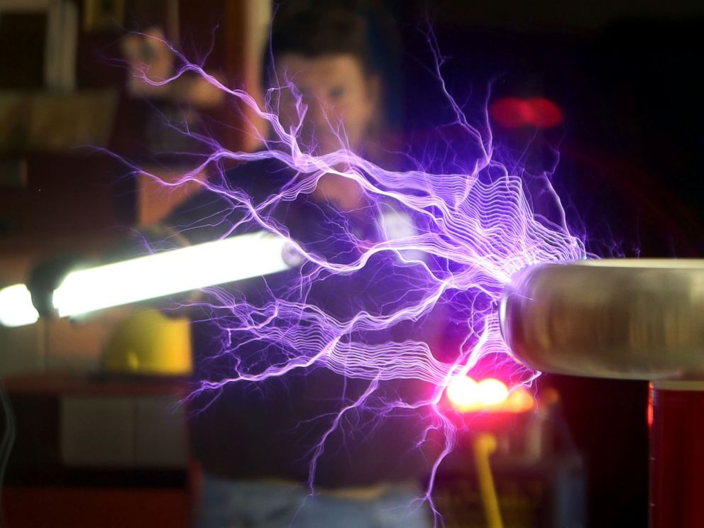 PHOTO: Instructor Robert Callier lights up a bulb with a Tesla coil that he built with students at Haney Technical School, Feb. 26, 2015, in Panama City, Fla.