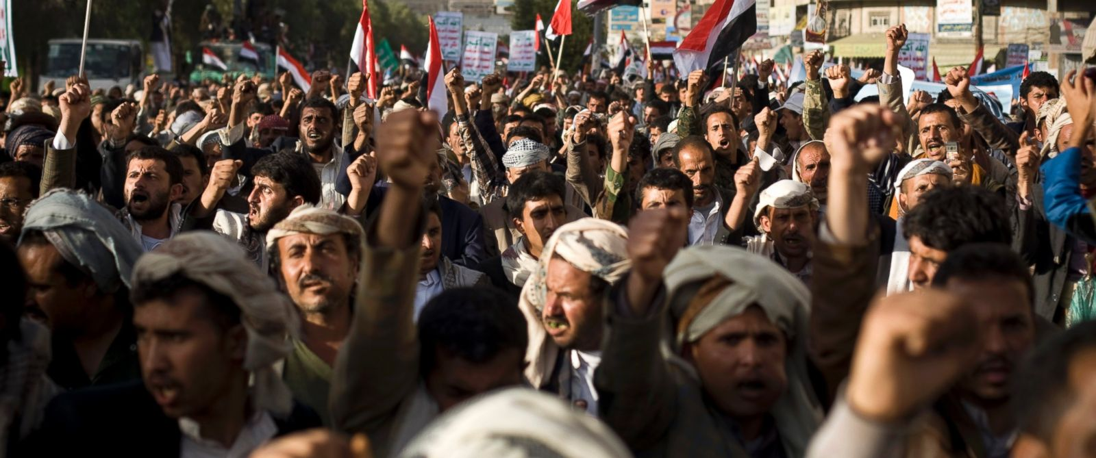 PHOTO: Supporters of Houthi Shiites shout slogans while marching on a street as they celebrate the fourth anniversary of the uprising in Sanaa, Yemen, Feb. 11, 2015.