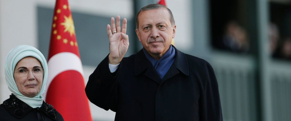 PHOTO: Turkish President Recep Tayyip Erdogan, accompanied by his wife Emine, left, waves to supporters prior to his speech during a rally one day after the referendum, outside the presidential palace, April 17, 2017, in Ankara, Turkey.