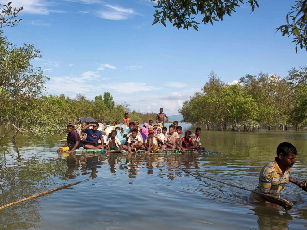 PHOTO: Rohingya Muslims travel on a raft made with plastic containers on which they crossed over the Naf river from Myanmar into Bangladesh, near Shah Porir Dwip, Bangladesh, Nov. 11, 2017. U.N.