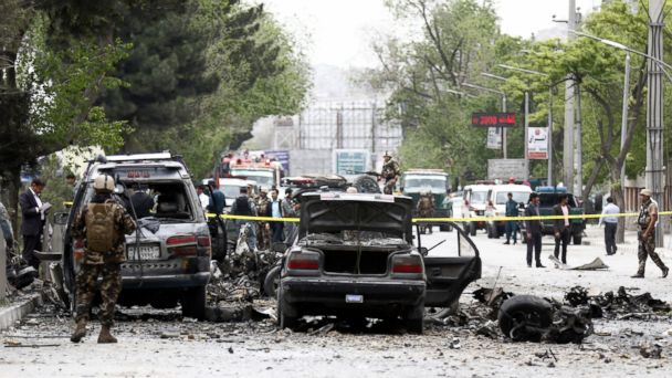 PHOTO: Afghan security officials inspect the site of a suicide bomb blast that targeted a NATO convoy near National Directorate of Security checkpoint, in Kabul, Afghanistan, May 3, 2017.