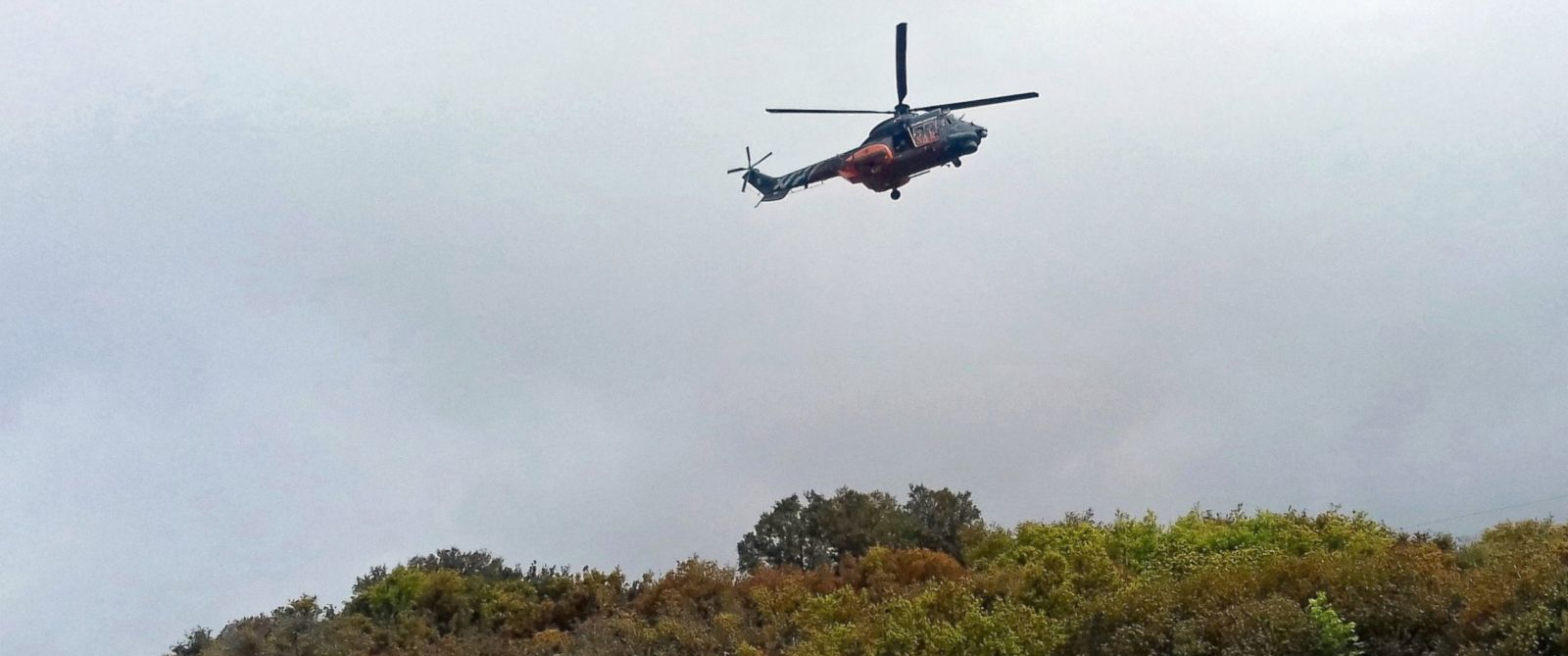 PHOTO: A military helicopter flies over the area where a UH-1H military helicopter crashed in the region of Elassona, Greece, April 19, 2017.