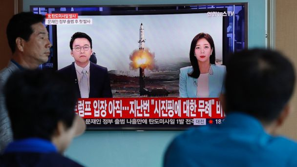 PHOTO: South Koreans watch a television displaying news broadcasts reporting on North Korea's recent ballistic missile launch, at a station in Seoul, South Korea, May 14, 2017.
