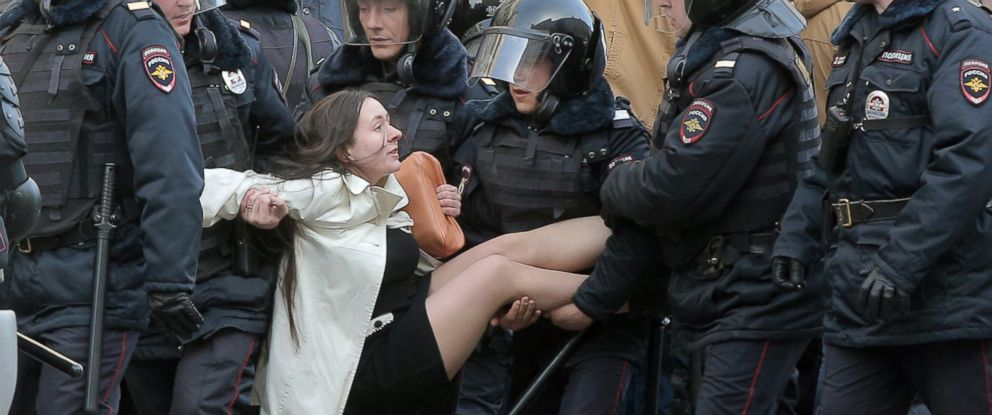 PHOTO: Russian riot policemen detain a demonstrator during an opposition rally in central Moscow, Russia, March 26, 2017.