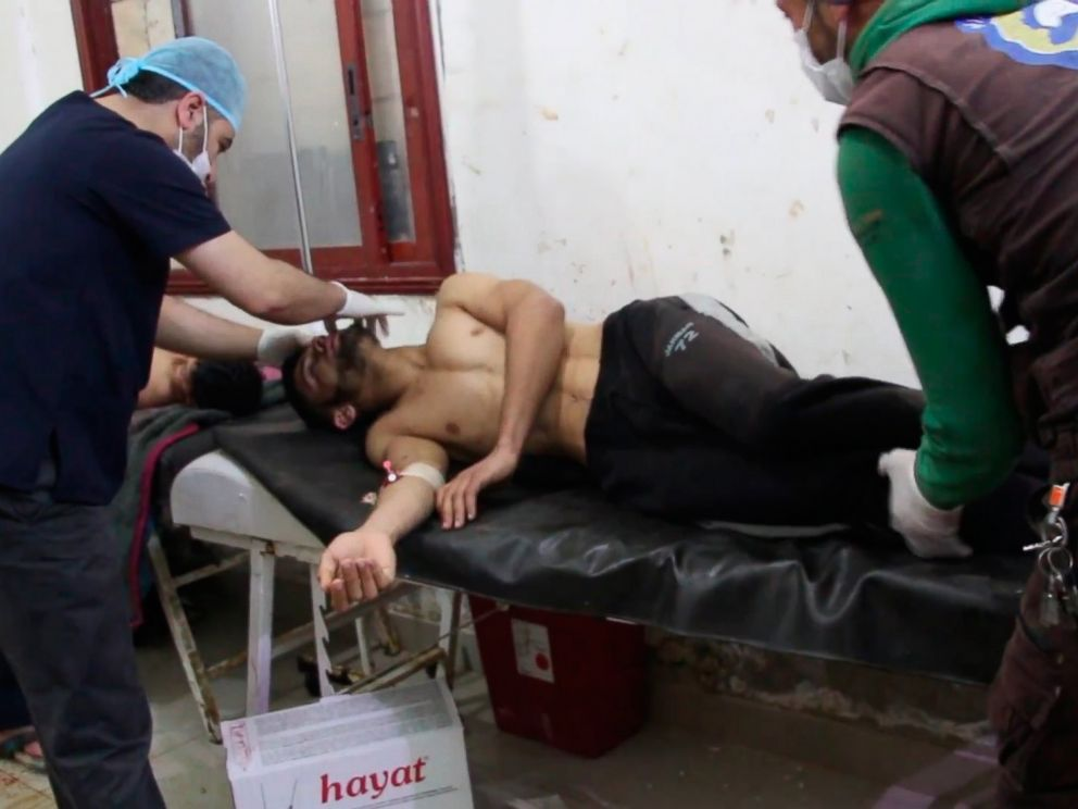 PHOTO: A video grabbed still image shows Syrian people receiving treatment after an alleged chemical attack at a field hospital in Saraqib, Idlib province, Syria, April 4, 2017.