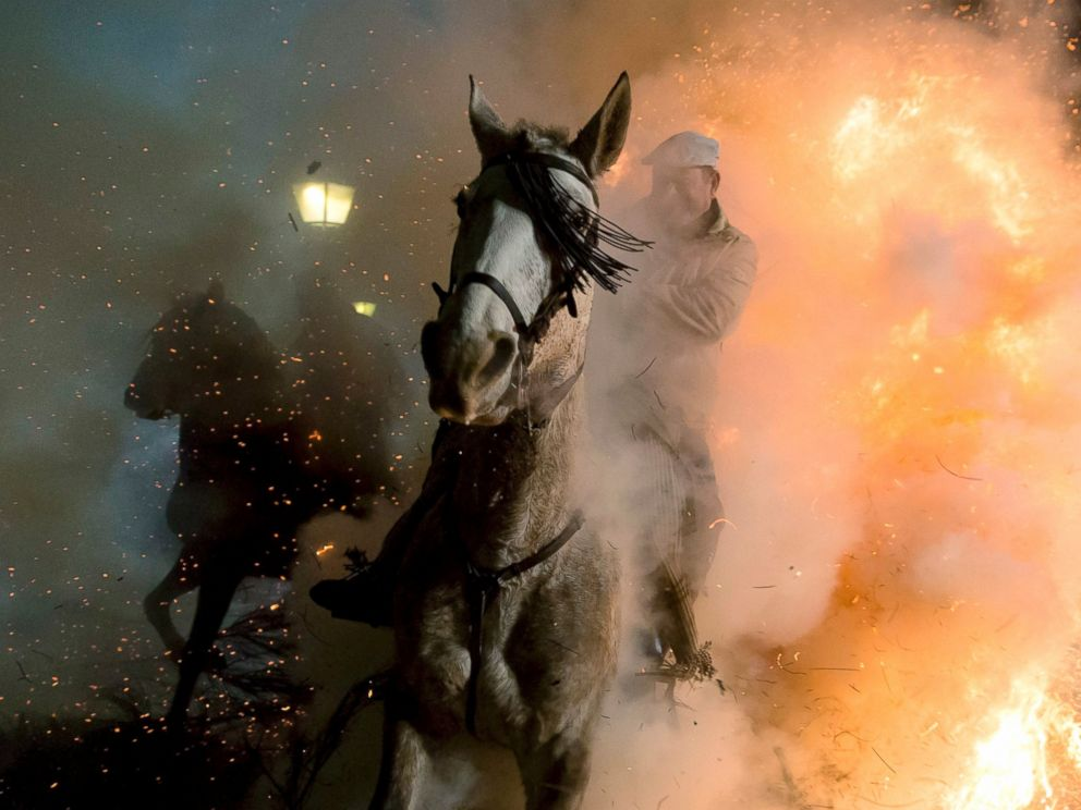 PHOTO: A rider jumps through a bonfire at the Luminarias in San Bartolome de Pinares, Avila, Spain, Jan. 16, 2017.