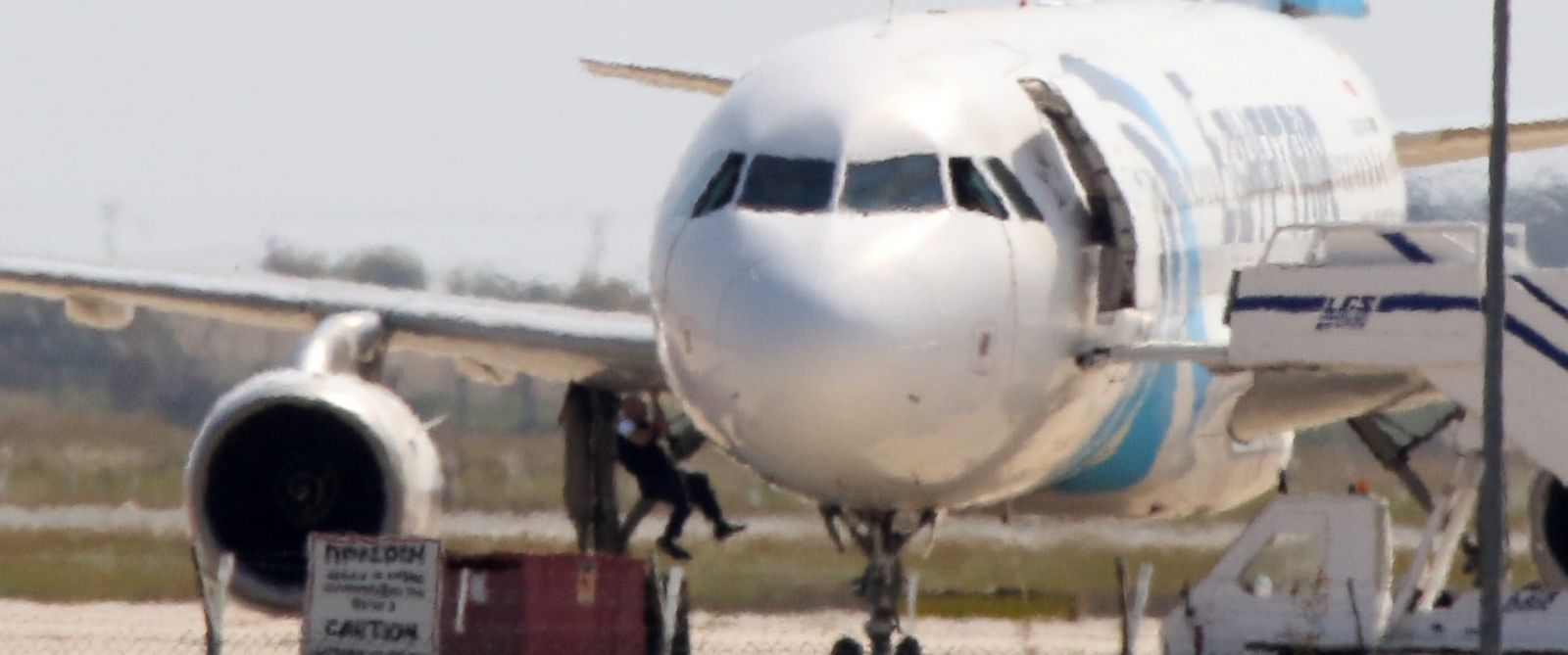 PHOTO: A person is seen here jumping out of the EgyptAir Flight 181 at Larnaca airport in Cyprus, March 29, 2016.