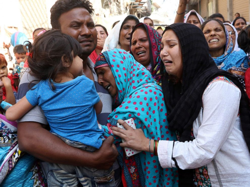 PHOTO: People cry during the funeral of their loved ones a day after a suicide bomb attack at a park on March 28, 2016, in Lahore, Pakistan.