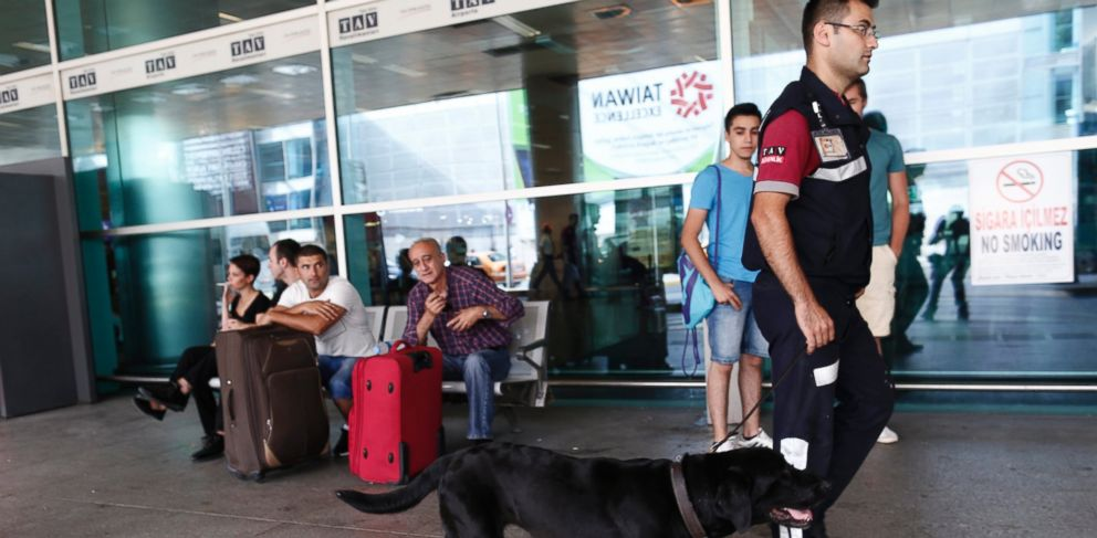 PHOTO: A security officer and his detection dog on patrol at Ataturk international airport in Istanbul, Turkey, June 29, 2016.