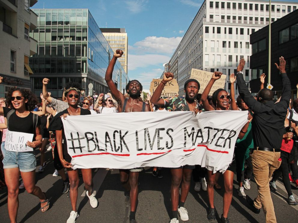 PHOTO: Demonstrators hold a banner with the motto of the black civil rights movement Black Lives Matter to show their solidarity with African Americans in the USA, in Berlin, Germany, July 10, 2016.