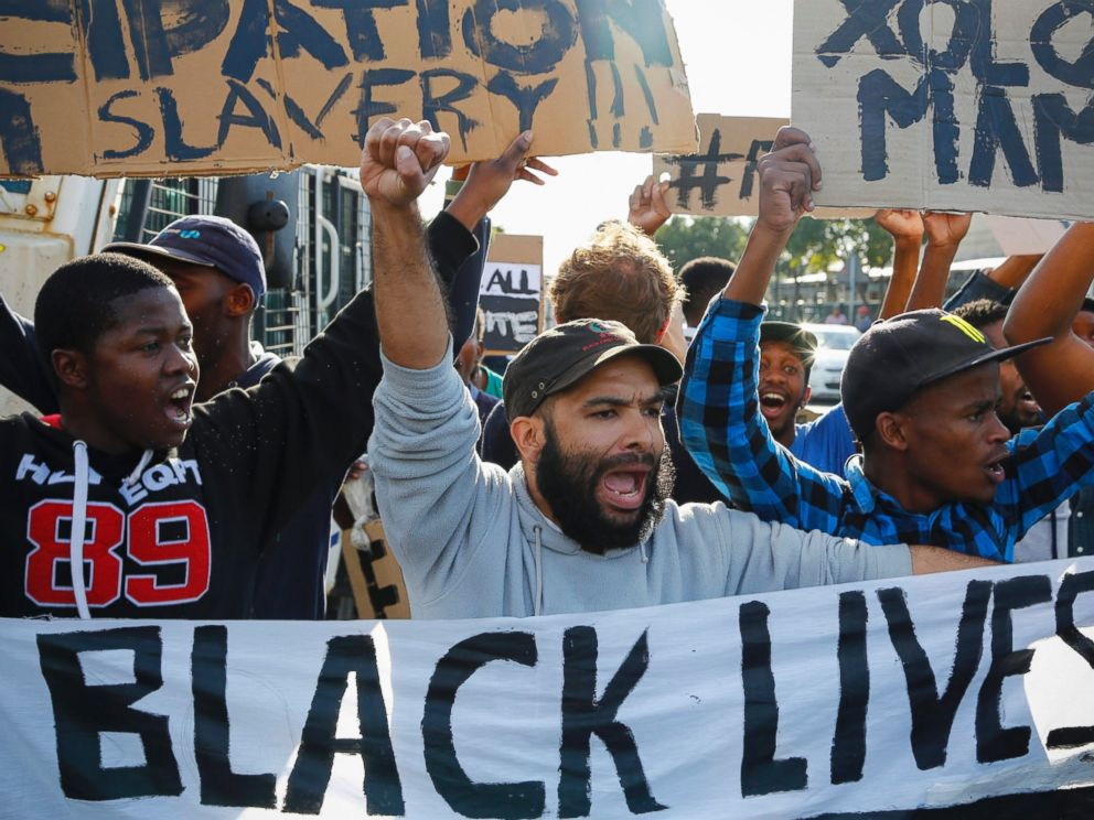 PHOTO: South Africans protest in support of the #BlackLivesMatter movement outside the US embassy in Cape Town, South Africa, July 13, 2016.