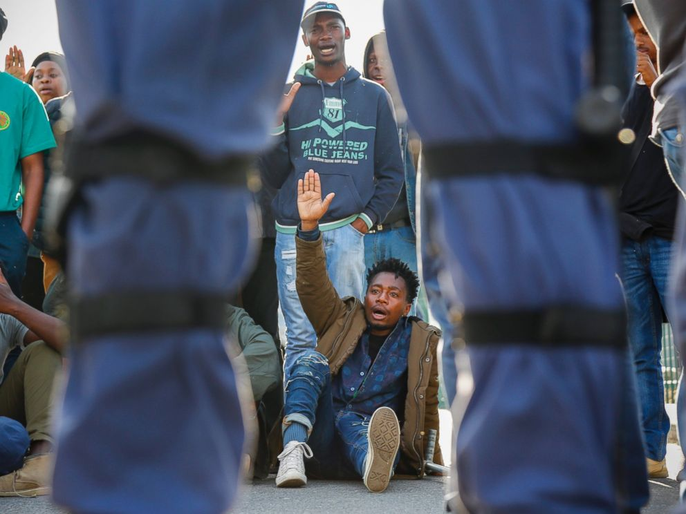 PHOTO: South Africans face police as they protest in support of the #BlackLivesMatter movement outside the US embassy in Cape Town, South Africa, July 13, 2016.