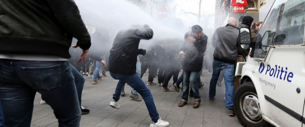 PHOTO: Anti-Islamic State demonstrators clash with Police at Place de la Bourse, at the site of the memorial for the victims of the 22 March terror attacks in Brussels, March 27, 2016.