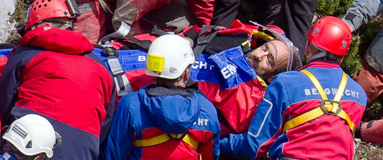 PHOTO: Rescue helpers carry injured cave explorer Johann Westhauser, center, on a stretcher near the entrance to the Riesending cave at Untersberg mountain near Marktschellenberg, Germany, June 19, 2014.
