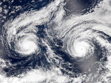 PHOTO: A handout image released by NASA Earth Observatory on Aug. 31, 2016 shows a satellite image of hurricanes Madeline (L) and Lester (R) over the Pacific Sea near Hawaii.