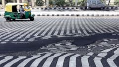 PHOTO: Road markings appear distorted as the asphalt starts to melt due to the high temperature in New Delhi, May 27, 2015.