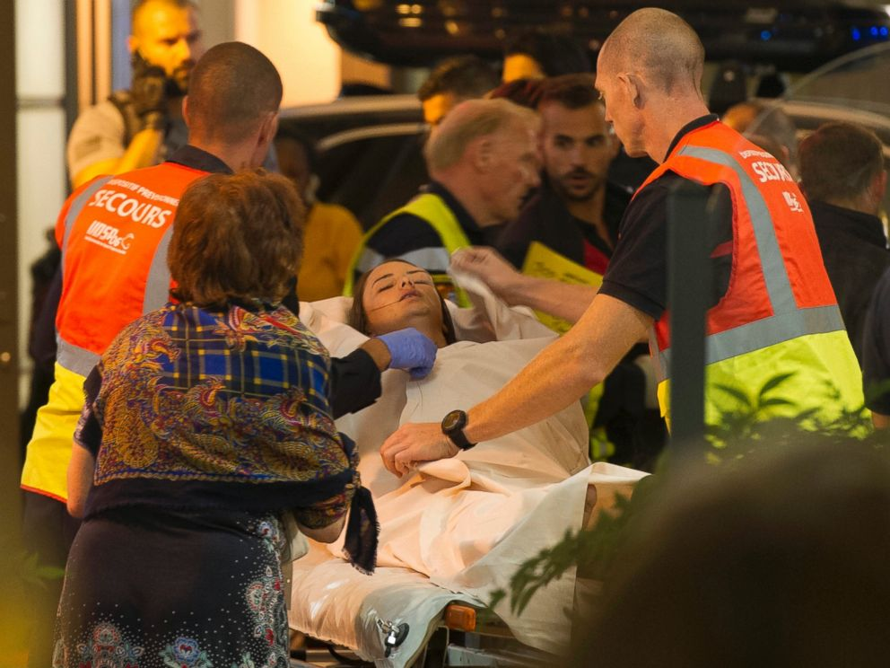 PHOTO: An emergency team assists wounded people as they evacuate from the scene where a truck crashed into the crowd during the Bastille Day celebrations in Nice, France, July 14, 2016