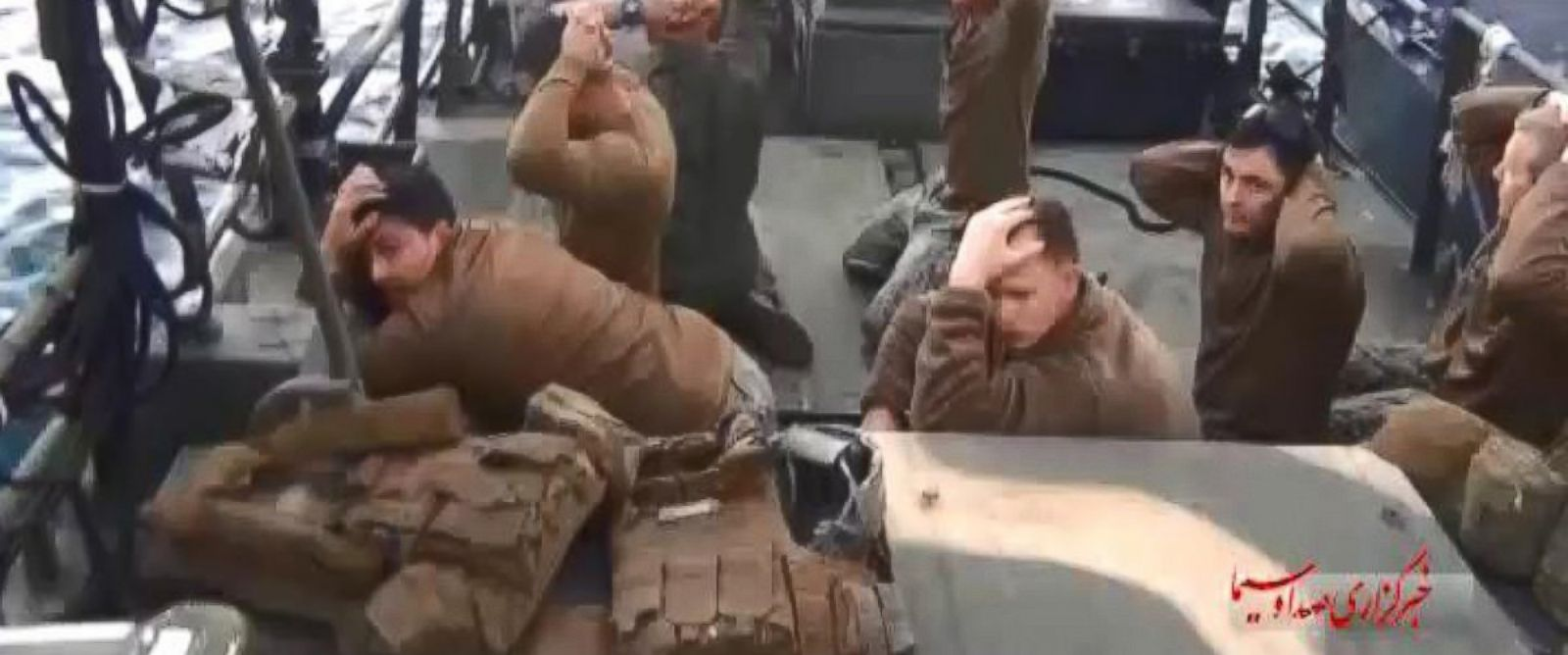 PHOTO: A handout TV grab made available shows American military personnel on their boat after they were captured by the Iranian Revolutionary Guard Corps (IRGC), at an undisclosed location in Iran, Jan. 12, 2016.