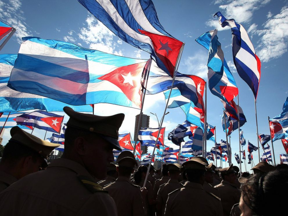 PHOTO: Demonstrators hold Cuban national flags as they participate in a march against terrorism, demanding justice for victims in Havana, Sept. 30, 2014.
