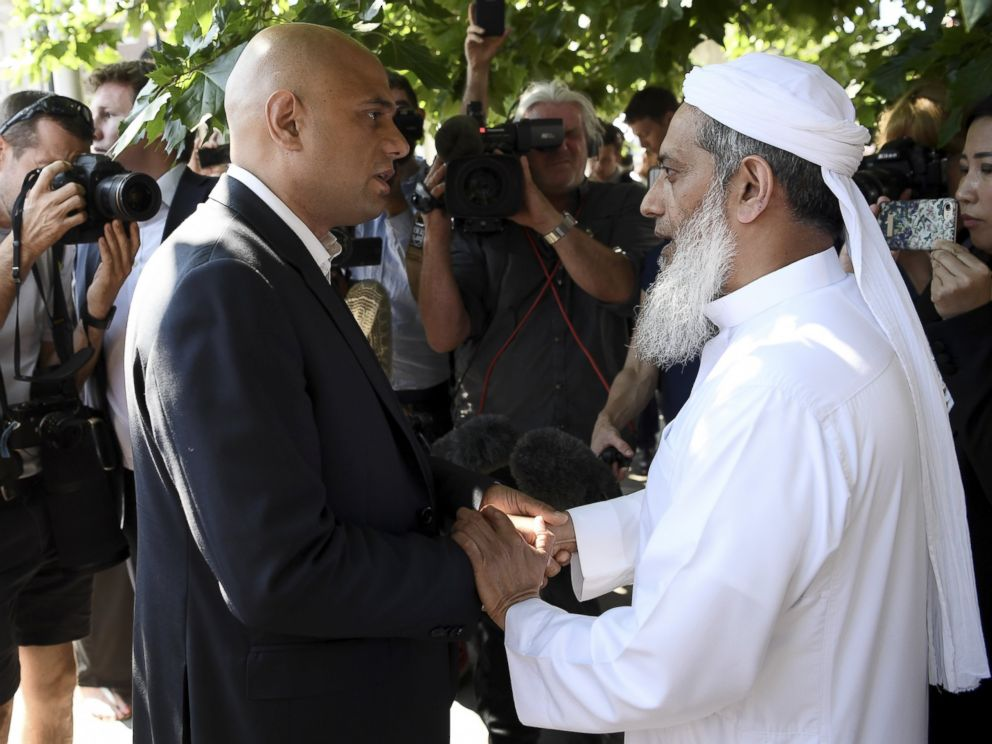 PHOTO: Secretary of State for Communities and Local Government Sajid Javid (L) speaks to an Imam at the scene of a terror attack in Finsbury Park, June 19, 2017, in London.