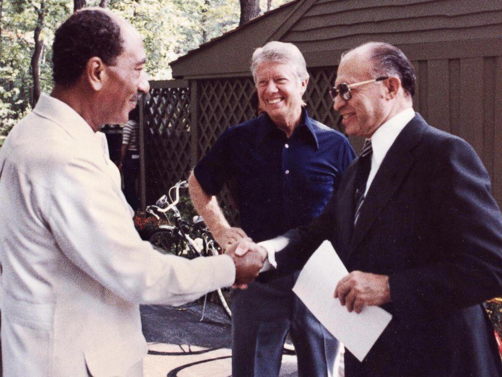 PHOTO: Egyptian President Anwar al-Sadat, left, shakes hands with Israeli Premier Menachem Begin, as President Jimmy Carter looks on September 6, 1978 at Camp David, the presidential retreat in Maryland.