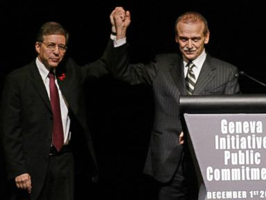 PHOTO: Former Israeli Justice Minister Yossi Beilin, left, and former Palestinian Information Minister Yasser Abed Rabbo celebrate the launching ceremony of the alternative Middle East plan at the Intercontinental hotel in Geneva, Dec. 1, 2003.
