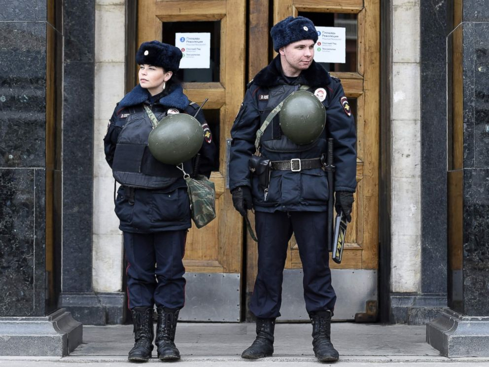 PHOTO:Police officers stand guard at the entrance to Ploschad Revolyutsii metro station, Apr. 4, 2017, in Moscow, as security measures are tightened the day after a deadly blast in the metro in St. Petersburg.