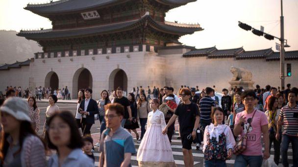 PHOTO: Pedestrians cross a street outside Gyeongbokgung palace in Seoul, South Korea, May 3, 2017.