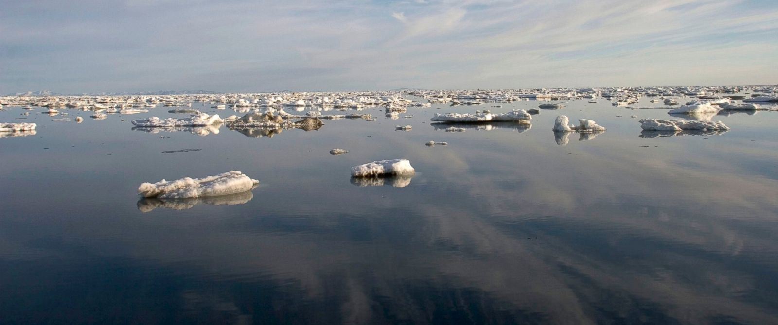 PHOTO: Melted ice chunks linger on the Chukchi Sea, normally a frozen expanse during the Spring Seal hunt, forcing local Inupiat Eskimos to use boats for this traditional subsistence fishing, June 9, 2005 in Shishmaref, Alaska.