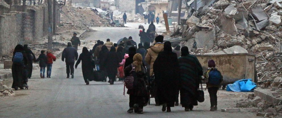PHOTO: Syrian civilians flee the Sukkari neighbourhood towards safer rebel-held areas in southeastern Aleppo, Dec. 12, 2016, during an operation by Syrian government forces to retake the embattled city.