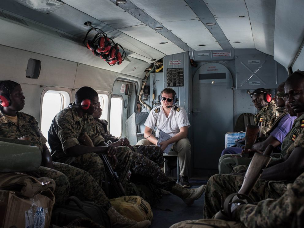 PHOTO: Members of the Uganda Peoples Defense Force (UPDF) serving in the African Union Mission in Somalia (AMISOM) travel in an United Nations helicopter on Oct. 10, 2016, departing from Mogadishu, Somalia.