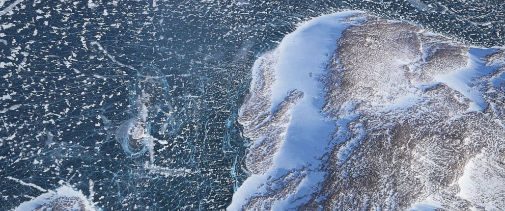 PHOTO: Sea ice (TOP) meets land as seen from NASAs Operation IceBridge research aircraft along the Upper Baffin Bay coast, March 27, 2017, above Greenland.