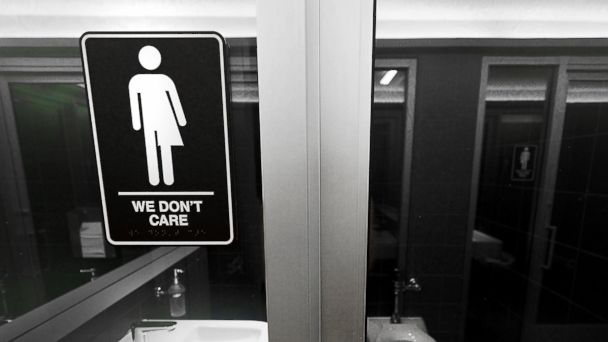 PHOTO: Gender neutral signs are posted in the 21C Museum Hotel public restrooms on May 10, 2016 in Durham, N.C.