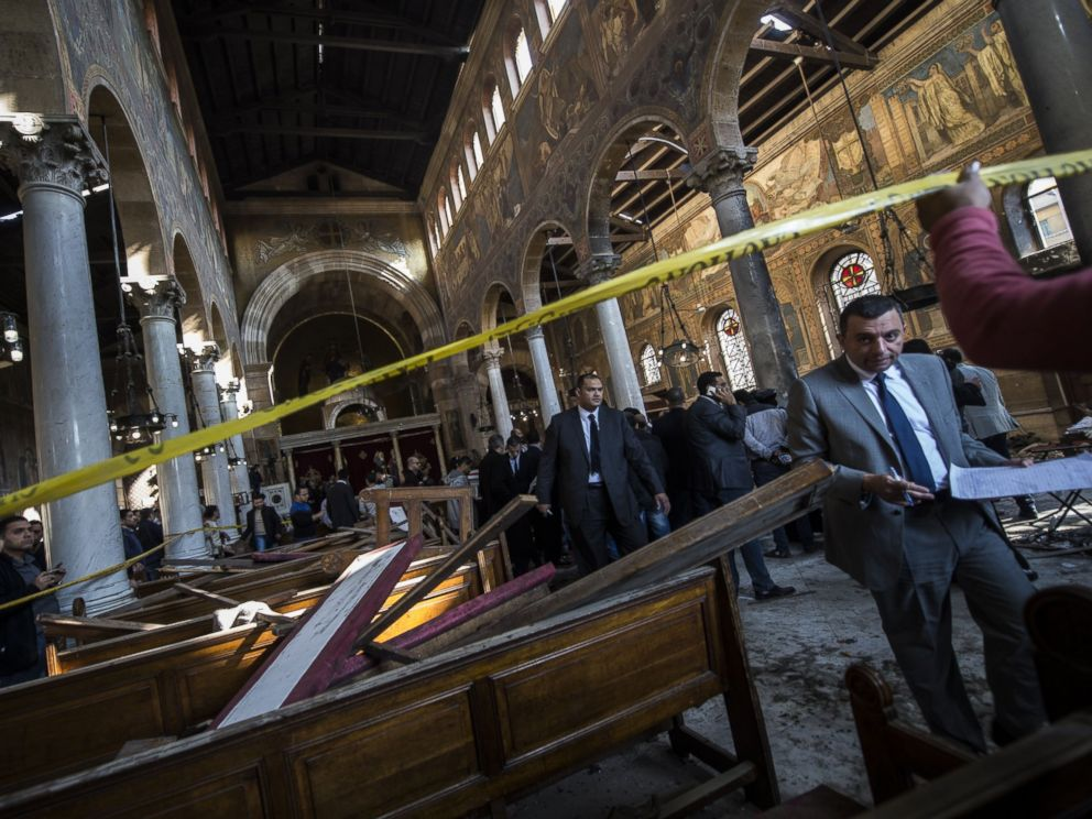 PHOTO: Egyptian security forces inspect the scene of a bomb explosion at the Saint Peter and Saint Paul Coptic Orthodox Church, Dec. 11, 2016, in Cairos Abbasiya neighborhood.