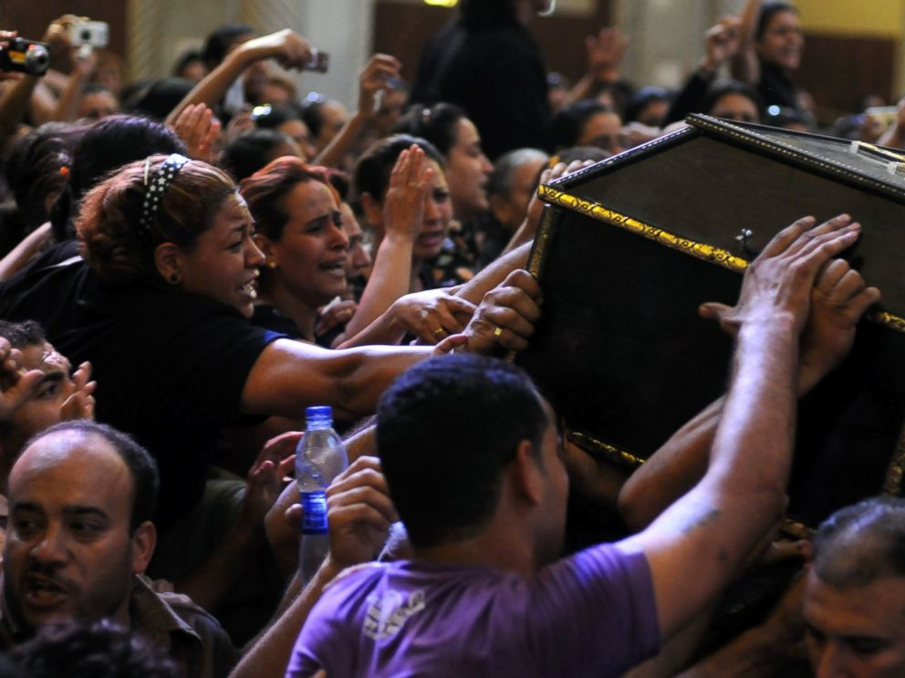 PHOTO: Egyptian Copts mourn over the coffin of a victim of deadly clashes, during a funeral at Abassaiya Cathedral in Cairo, Oct. 10, 2011, a day after 24 people, mostly Christians, died in clashes with Egyptian security forces.