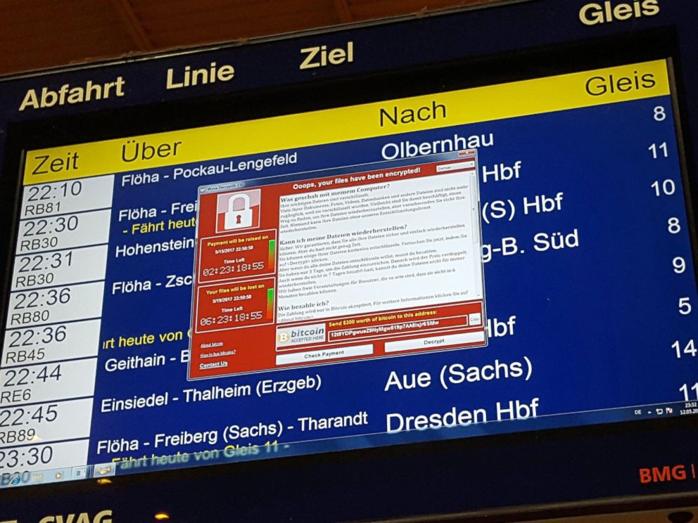 PHOTO: A window announcing the encryption of data including a requirement to pay appears on an electronic timetable display at the railway station in Chemnitz, eastern Germany, May 12, 2017.