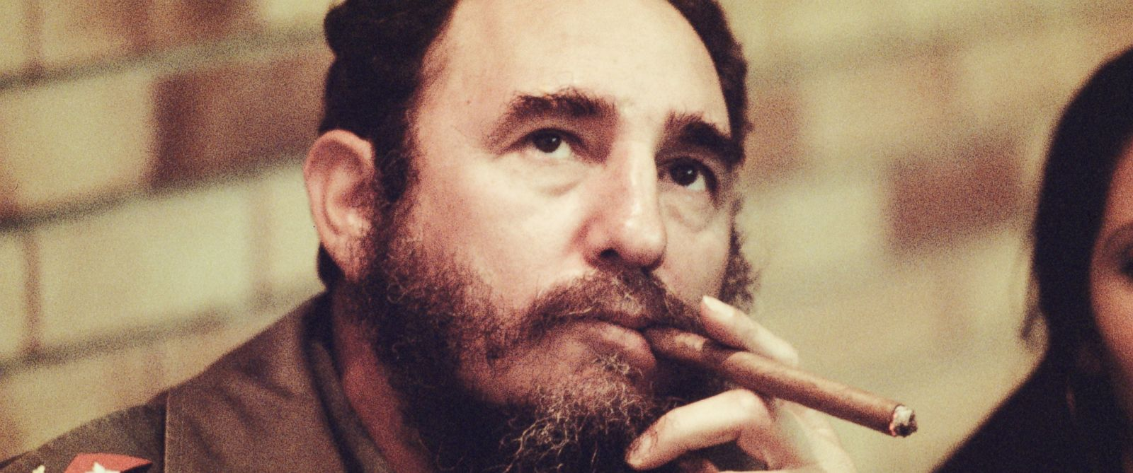 PHOTO: Fidel Castro smokes a cigar in his office in Havana, Cuba, 1977.