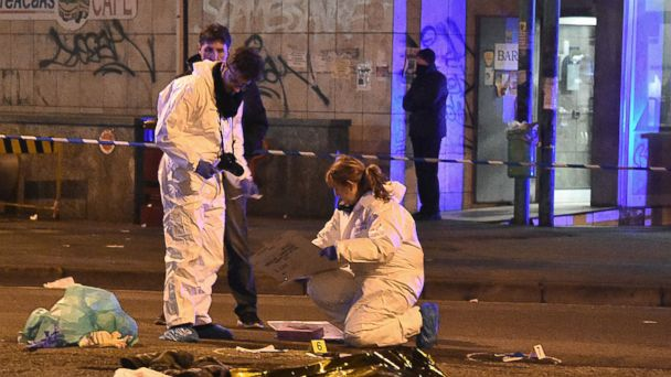 PHOTO: Italian police and forensics experts gather around the body of suspected Berlin truck attacker Anis Amri after he was shot dead in Milan, Dec. 23, 2016.