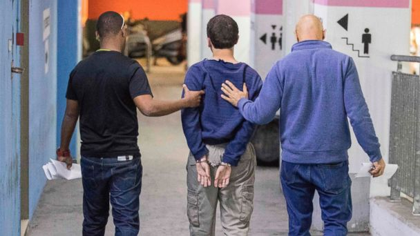 PHOTO: An American-Israeli teenager, accused of making dozens of anti-Semitic bomb threats in the United States and elsewhere, is escorted by guards as he leaves the Israeli Justice court in Rishon LeZion, Israel, March 23, 2017.
