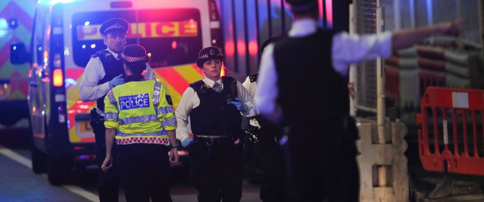 PHOTO: Police officers run at the scene of an apparent terror attack on London Bridge in central London on June 3, 2017.