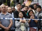 PHOTO: Members of the public view the scene after police officers raided a property in East Ham, June 4, 2017 in London, England.