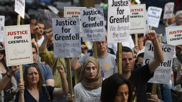 PHOTO: Protesters attend a rally calling for justice for those affected by the Grenfell Tower fire outside the Department for Communities & Local Government, June 16, 2017, in London.