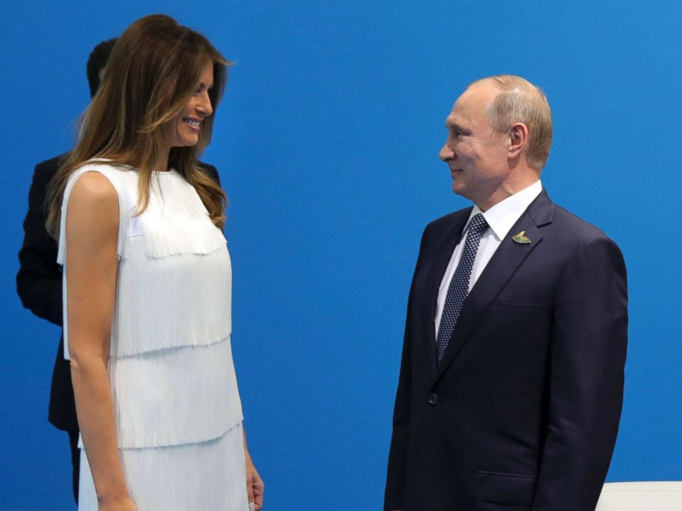 PHOTO: Russian President Vladimir Putin greets first lady Melania Trump during the G20 summit in Hamburg Germany, July 7, 2017.