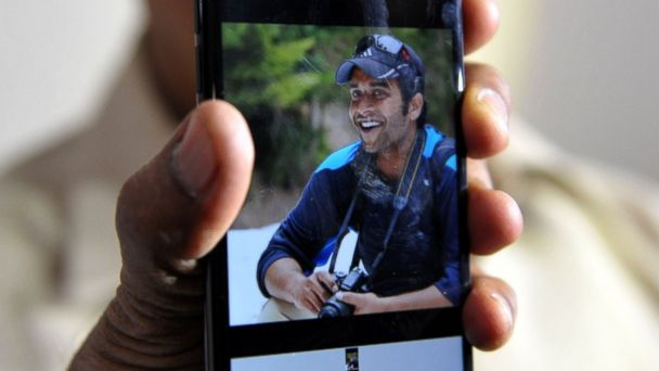 PHOTO: Indian man Jagan Mohan Reddy holds a smartphone with an image of his son Alok Madasani at his residence in Hyderabad, Feb. 24, 2017, after Alok was injured in a shooting in the US state of Kansas.